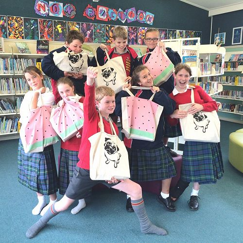 Summer Readers with their bags of books and goodie