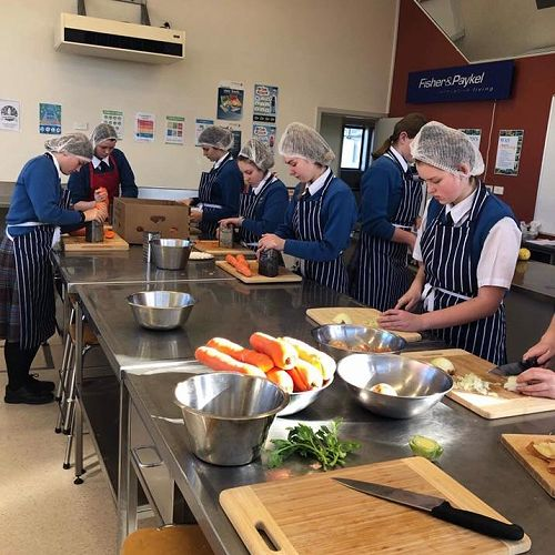 Interact Group prepare vegetables for Bellyful Dunedin.