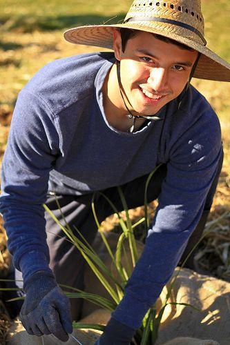 Robert Lemus planting at Sinclair Wetlands.