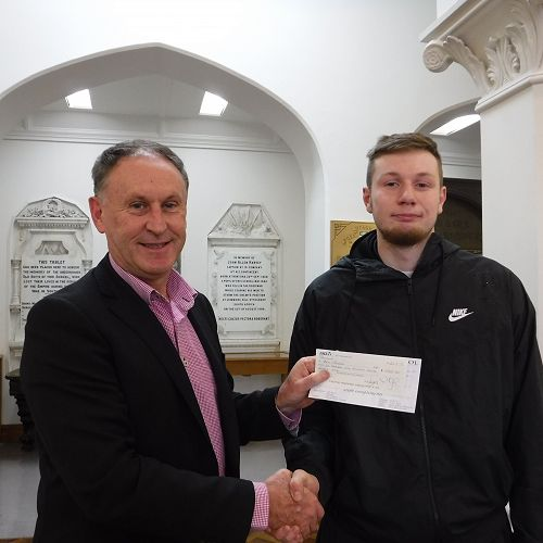 Geoff Bates presenting the cheque to Ben Reeves