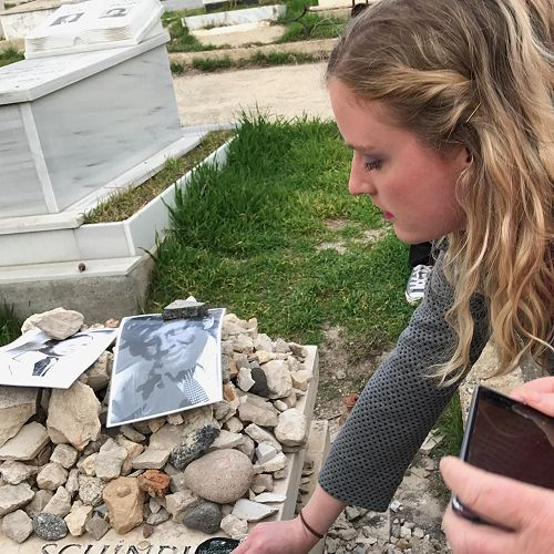Laying a stone on Oskar Schindler's Grave.