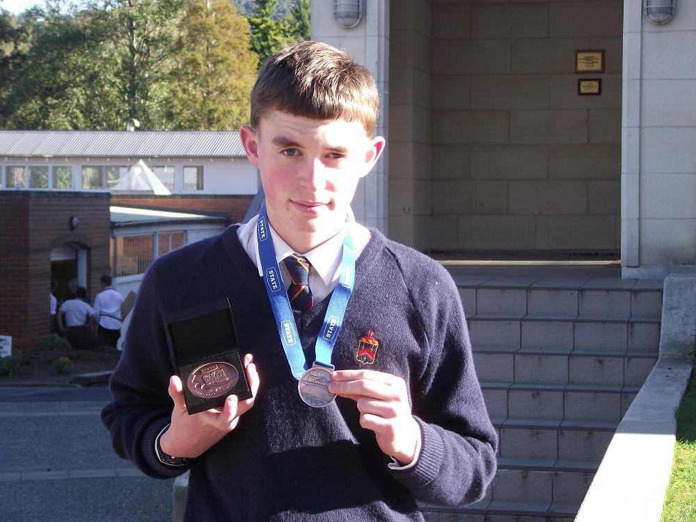 Cameron Moran with his Bronze Medals from the NZ Ocean Swim Series