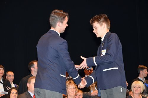 2016 Deputy Head Boy Sam Kilsby congratulating Hun