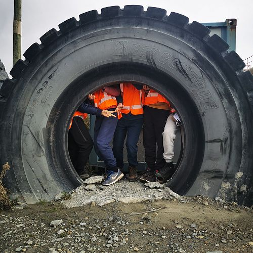 Ever wondered how many Year 11 students fit in a recycled dump truck tyre? The answer is 9!!