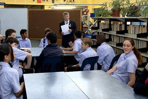 Year 13 student, Sam Ashton, organising students for a school tour.