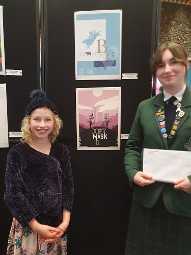 """Aidan Forbes and her little sister beside her winning Design """"Don't Mask It""""."""