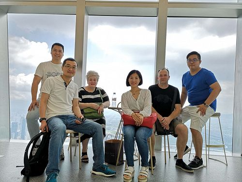 The sales team and a client team atop Shenzhen's tallest building. At 600m high it is the second tallest in China.