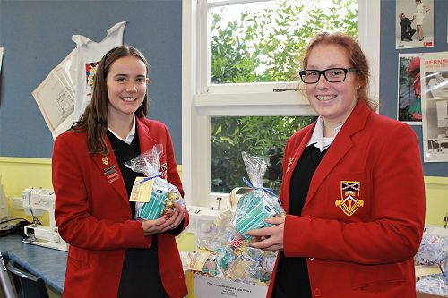 Year 12 students Rebekah and Nerissa help prepare