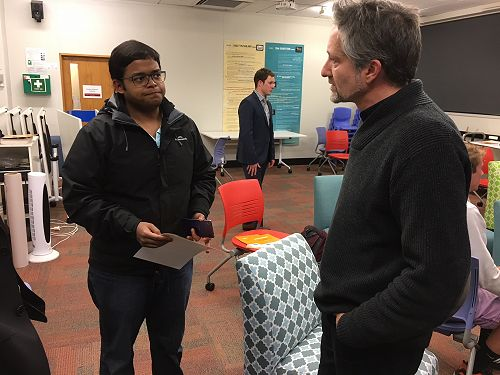 Andrew Wallace speaking with Rahul Sen.