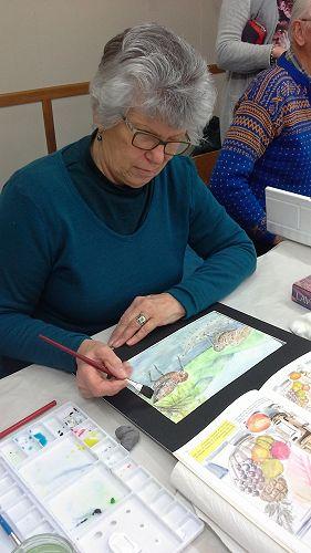 Leonie Tait finishes off her stunning work