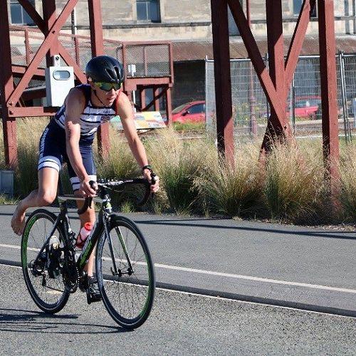 Jack Divers prepares to dismount his bike