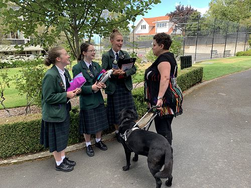 Megan Turnbull (School Counsellor) with her guide dog, Oban.