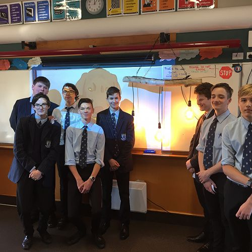 "Bespoke Otago with a prototype of their custom made lights that ""bring the beach to your home"" From left; Jack Flaws, Ben Black, Jonty Lydiate, Judd Stewart, Andre Colson, Michael Galliven, Thomas Lister & Jimi Higgins"