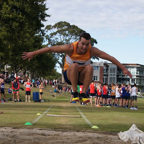 Rory Ferguson competes with style in the triple jump.