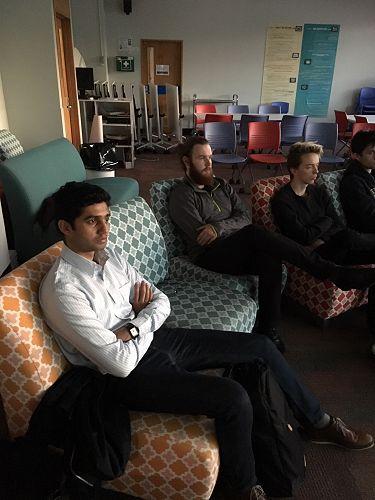 AJ, Kirio and Finn listening to Rebecca's presenta