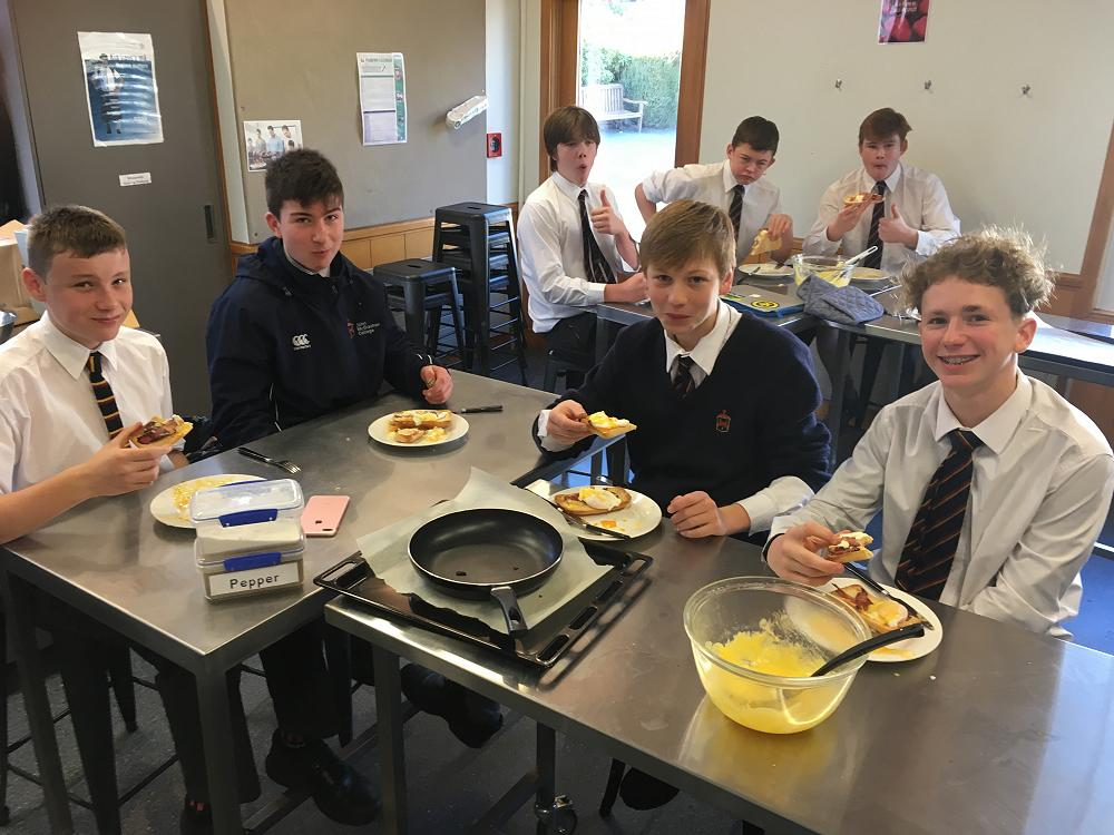 Year 10 boys enjoying Eggs Benedict for breakfast with their home made Hollandaise sauce.