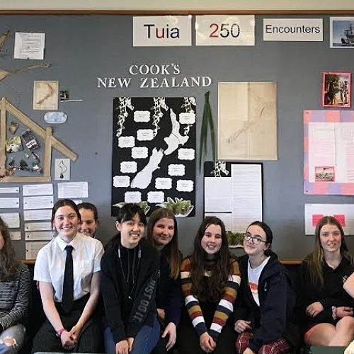 Year 11 History with their exhibition. Ka pai!