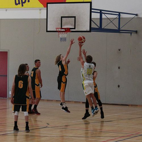 Rob Aylwin up for the basket for the Past with Tom O'Brien defending for College Boys'