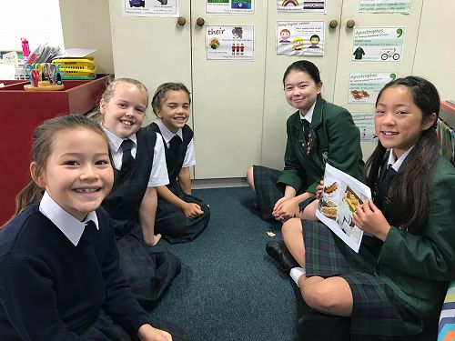 Year9 students present their Chinese New Year research to Year 4 students