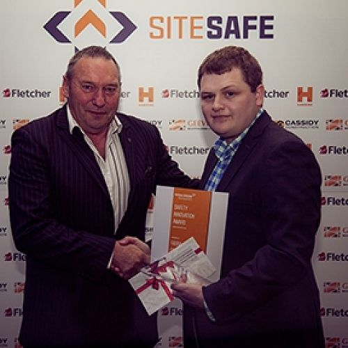 Health and Safety Manager Logan Miller receives the award on behalf of Farra.