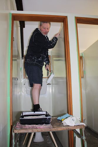 Paul working on the ceiling