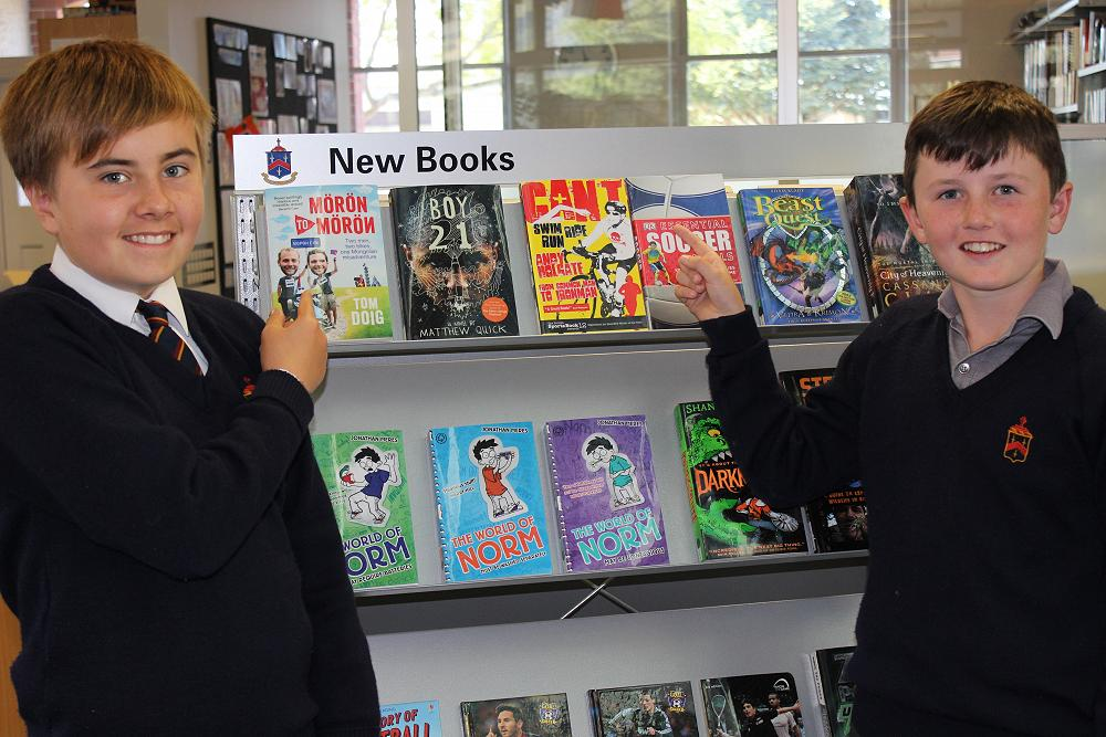Benedict Kyle and Sam Hope promoting the new books in the library