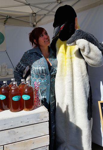 Heidi from Dragonfly Unbakery introducing Jack our Wild Dunedin penguin to kombucha.