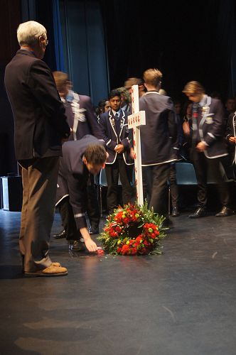 Prefects lay a poppy at the ANZAC Ceremony