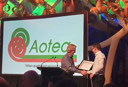 Ben Richardson receiving his Scholarship Certificate at the Aotea AGM at Te Papa from Murray Hughes, May 2019