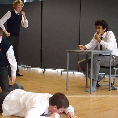 """JMC Improv team during """"Sit, Stand, Kneel, Lie"""" game"""