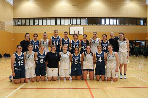 Columba and STAC Basketball teams