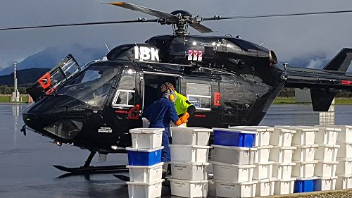 Helicopter and tubs at Manapouri Airport.