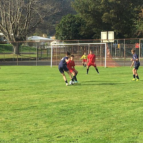 WCSS Football Tournament 2019 Reefton - Jacob Lowe in competition against Buller HS (red) as Kayne Wall supports.