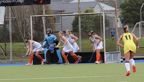 Columba defending their goal in a penalty corner