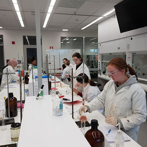 Year 13 Chemistry students in the Otago University Laboratories.