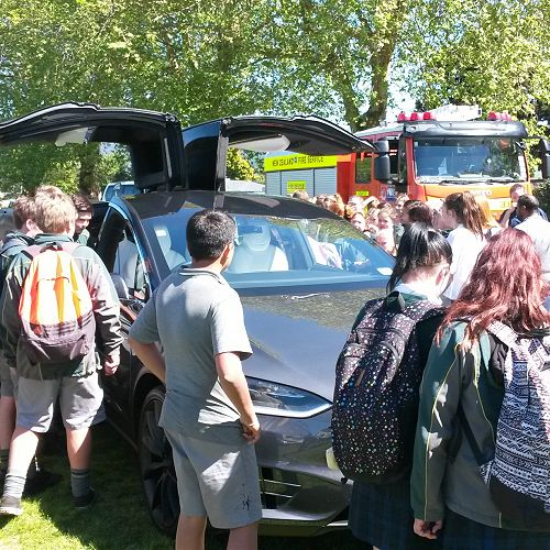 Students around the Tesla X