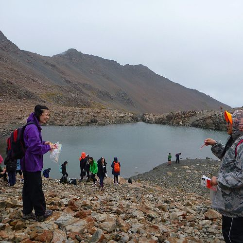 Inise Manu (right) directs Lisa Patmore (left) to where the next sample should be taken at Bill's Basin.