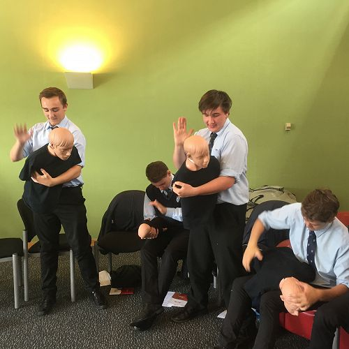 Practising the technique required to help someone who is choking. From left; Ewan Stewart, Caleb Tikey, Joe Landrebe and Max Aitcheson.