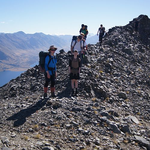 Clambering over the final 'false summit' before the top of Mt Campbell