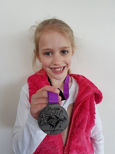 Riley with her medal