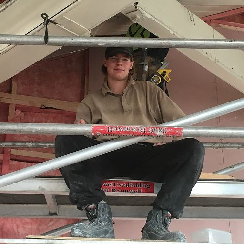 Zach White sits proudly on top of thescaffolding at his Gateway placement