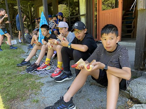 Our 4 Thai boys trying out the Kiwi delicacy of sa