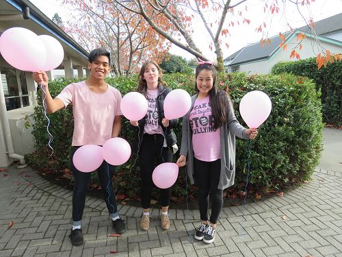 Daeniel, Emma and Pema celebrate Pink Shirt Day