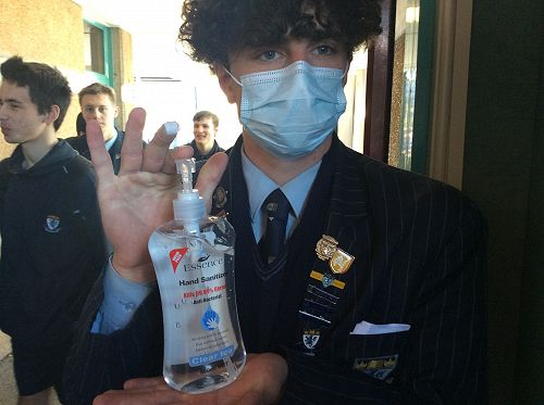 James Nicolson getting ready to sanitize each students hands before they vote
