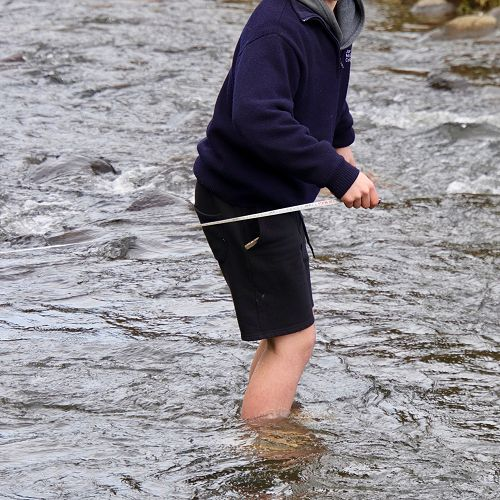 George Connor braves the not overly warm waters of Leith as only a Stewart Island man can, barefoot.