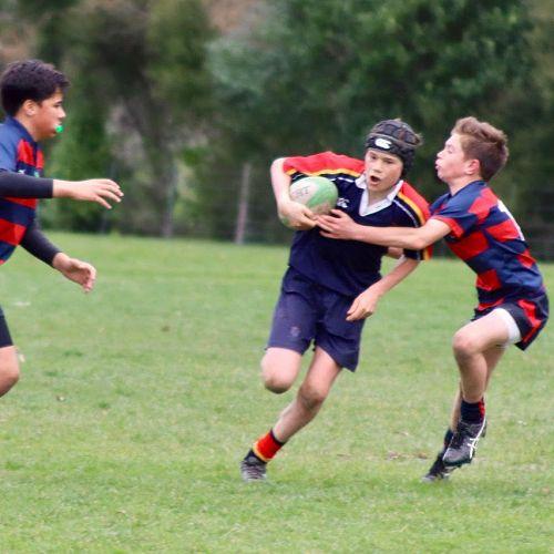 Connor Aldrich runs through a tackle