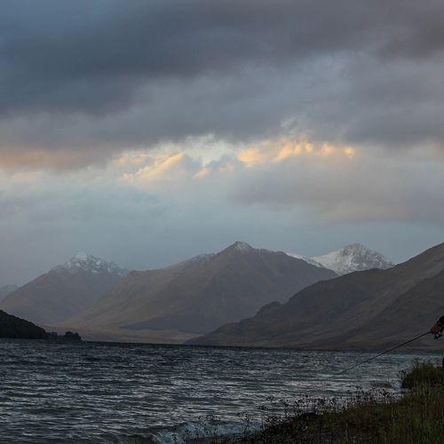 Mr Brown fishing as the rain clears