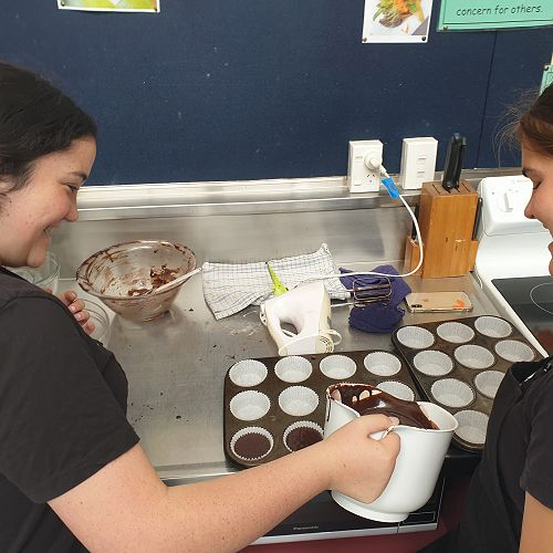 Zeāhn Otene and Sarah Wilson Making Cupcakes