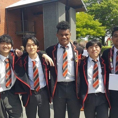 2019 International Leavers after receiving their Old Boys ties