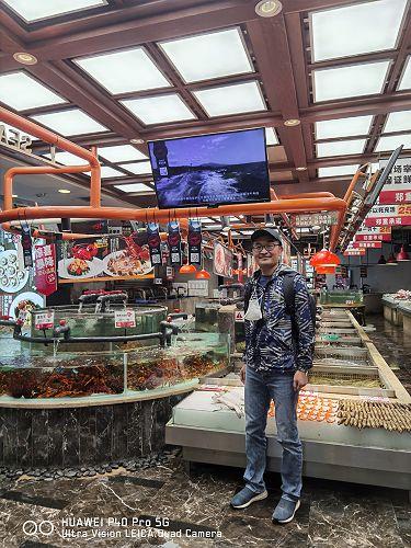 FLC China Chief Representative Joe Zhong checking on a recent in-restaurant Wild Legend promo.